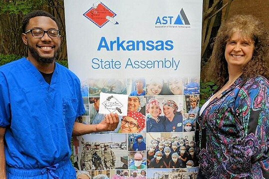 ARSA President Cindy Lewis (right) stands with Daniel Castleberry Memorial Scholarship winner J'Quan Brammer (left).